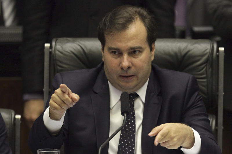 Brazil's Lower House Speaker Rodrigo Maia speaks during a key vote by the lower chamber on whether to suspend President Michel Temer and put him on trial over an alleged bribery scheme to line his pockets, in Brasilia, Brazil, Wednesday, Aug. 2, 2017. Temer appeared to have the upper-hand and is confident he can survive bribery charge vote. (AP Photo/Eraldo Peres)