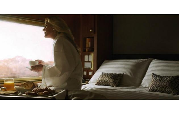 Experience waking up with a rare view of Australia's outback, while travelling on the luxe Ghan Platinum.