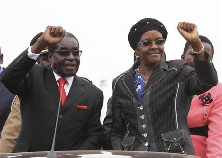 Zimbabwean President Robert Mugabe and his wife Grace wave to supporters and guests during celebrations to mark his 90th birthday in Marondera