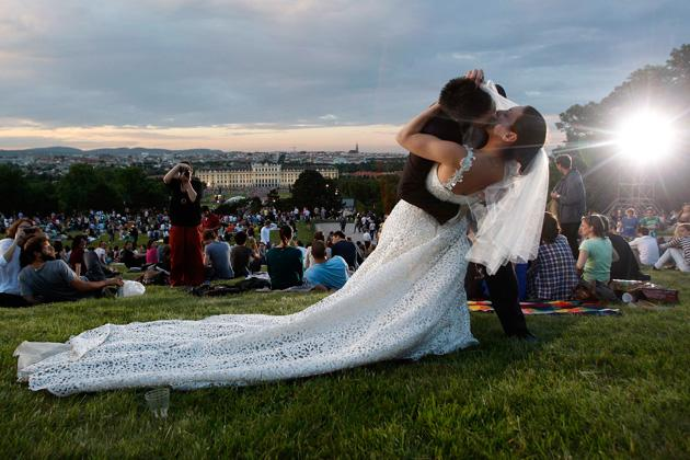 A couple from Poland kiss after their marriage, during the Summer Night Concert (Sommernachtskonzert) of the Vienna Philharmonic Orchestra (Wiener Philharmoniker) in Vienna June 7, 2012. The popular open-air concert with free admission is visited by around 100,000 people and takes place in the setting of Schoenbrunn palace and its baroque gardens, a UNESCO world cultural heritage site. REUTERS/Lisi Niesner
