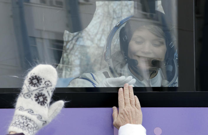 U.S. astronaut Anne McClain, member of the main crew to the International Space Station (ISS), interacts with her family from a bus prior to the launch of Soyuz-FG rocket at the Russian leased Baikonur cosmodrome, Kazakhstan, Monday, Dec. 3, 2018. (AP Photo/Dmitri Lovetsky, Pool)
