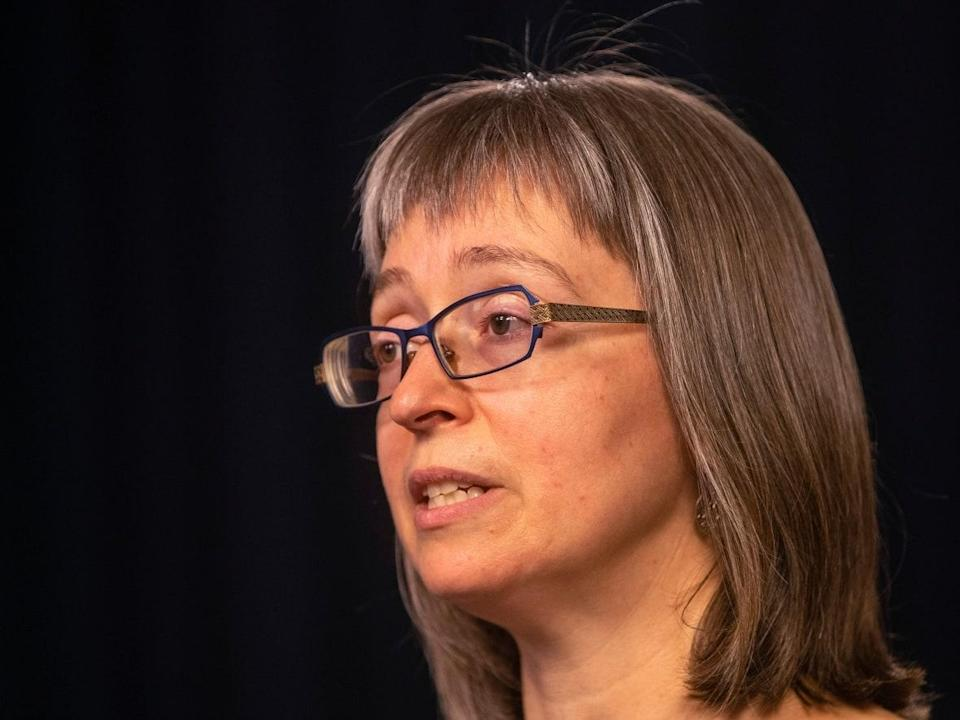 Dr. Deena Hinshaw, Alberta's chief medical officer of health, said the Alberta government, in the future, will not publicly report any COVID-19 deaths in anyone under 18 until a review of the death has been completed. (Jason Franson/The Canadian Press - image credit)