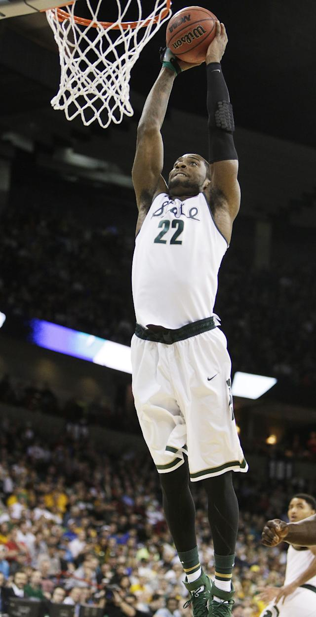 Michigan State's Branden Dawson (22) dunks in the first half during the third-round game of the NCAA men's college basketball tournament against Harvard in Spokane, Wash., Saturday, March 22, 2014. (AP Photo/Young Kwak)