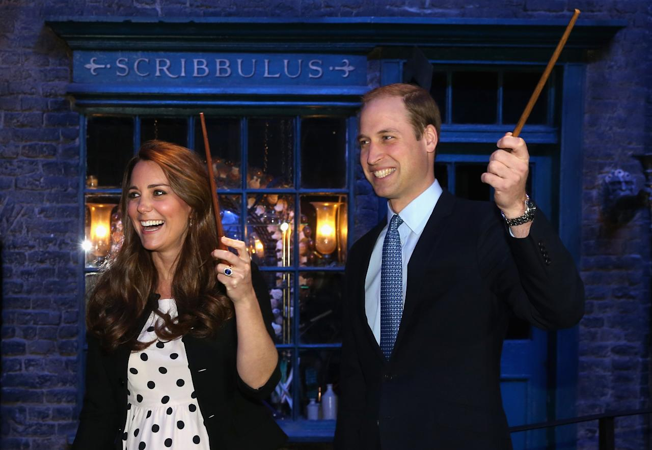 LONDON, ENGLAND - APRIL 26:  Catherine, Duchess of Cambridge and Prince William, Duke of Cambridge share a joke on the set used to depict Diagon Alley in the Harry Potter Films  during the Inauguration Of Warner Bros. Studios Leavesden on April 26, 2013 in London, England.  (Photo by Chris Jackson/Getty Images)