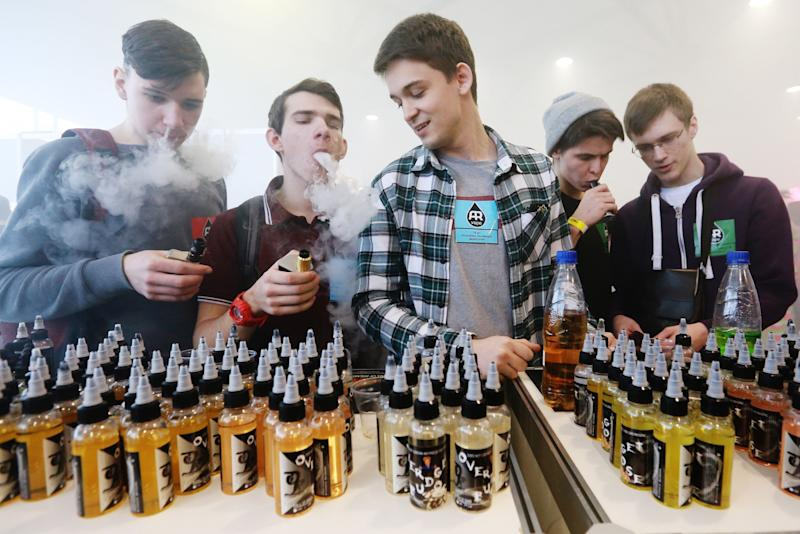 ST PETERSBURG, RUSSIA - MARCH 4, 2017: Teenaged visitors smoking electronic cigarettes at the 2017 Vapexpo Spb exhibition of the vape industry at Lenexpo. Sergei Konkov/TASS (Photo by Sergei Konkov\TASS via Getty Images)
