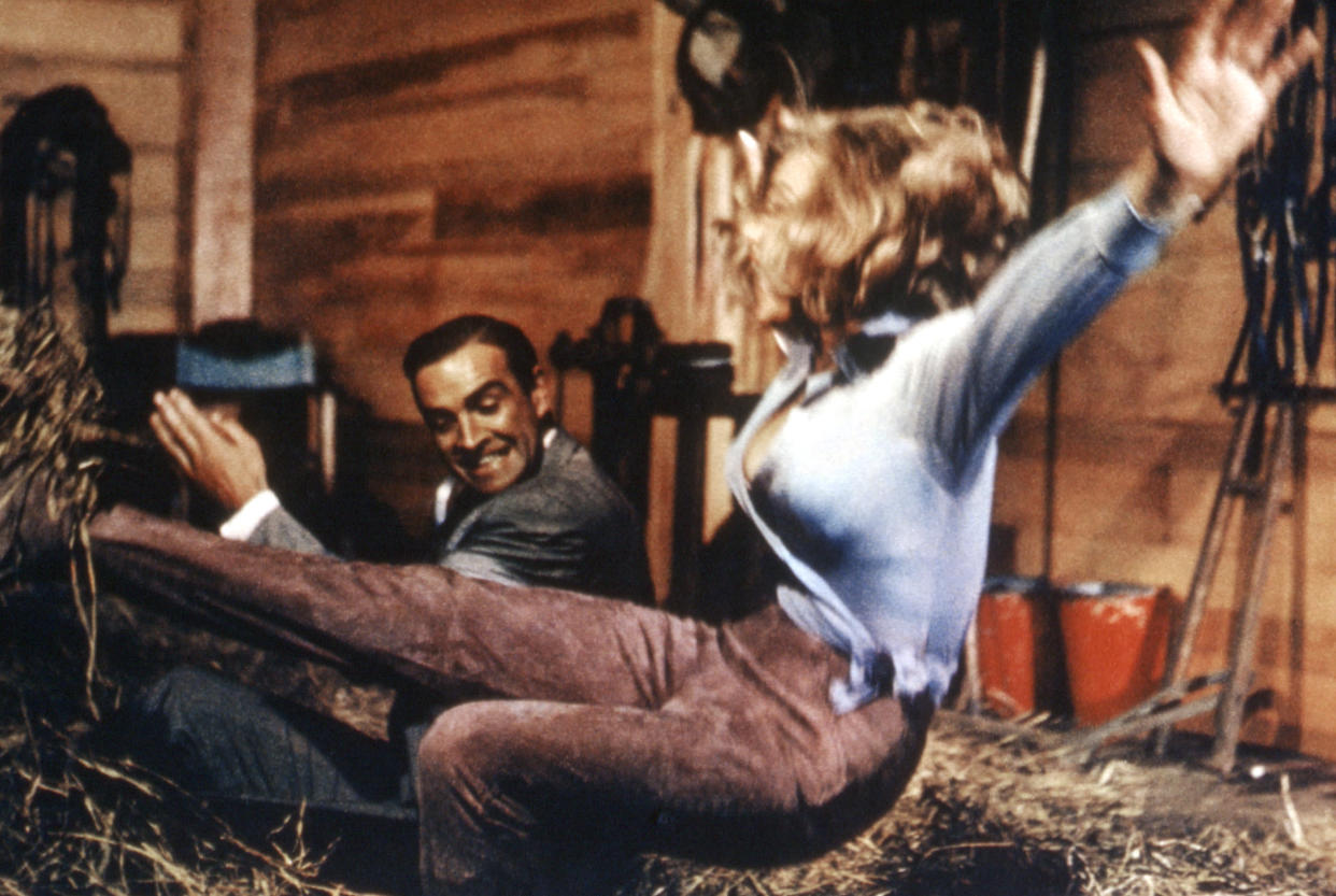 Connery and Honor Blackman in a controversial scene from Goldfinger (Photo: Courtesy Everett Collection)