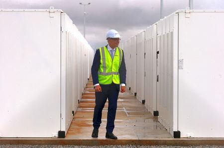 South Australian Premier, Jay Weatherill walks around the compound housing the Hornsdale Power Reserve, featuring the world's largest lithium ion battery made by Tesla, during the official launch near the South Australian town of Jamestown, in Australia, December 1, 2017. REUTERS/David Gray