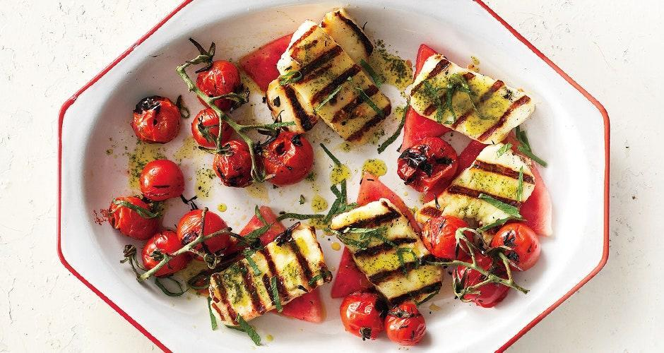 """You'll want to drizzle this oil over everything. <a href=""""https://www.bonappetit.com/recipe/grilled-halloumi-with-watermelon-and-basil-mint-oil?mbid=synd_yahoo_rss"""" rel=""""nofollow noopener"""" target=""""_blank"""" data-ylk=""""slk:See recipe."""" class=""""link rapid-noclick-resp"""">See recipe.</a>"""