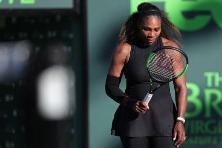 Mar 21, 2018; Key Biscayne, FL, USA; Serena Williams of the United States looks at her racket after missing a shot against Naomi Osaka of Japan (not pictured) on day two of the Miami Open at Tennis Center at Crandon Park. Osaka won 6-3, 6-2. Mandatory Credit: Geoff Burke-USA TODAY Sports
