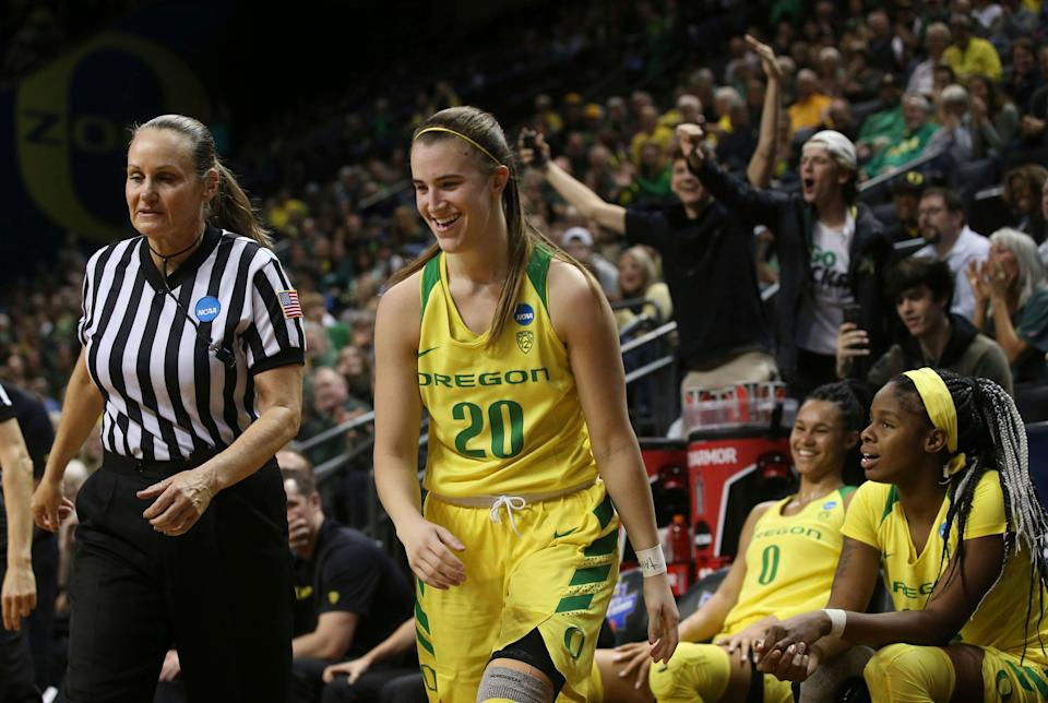 Fans react to a technical foul call, right, after Oregon's Sabrina Ionescu, center, stepped off the bench to shoot an out-of-bounds ball during the closing seconds of a first-round game against Portland State in the NCAA women's college basketball tournament Friday, March 22, 2019, in Eugene, Ore. (AP Photo/Chris Pietsch)