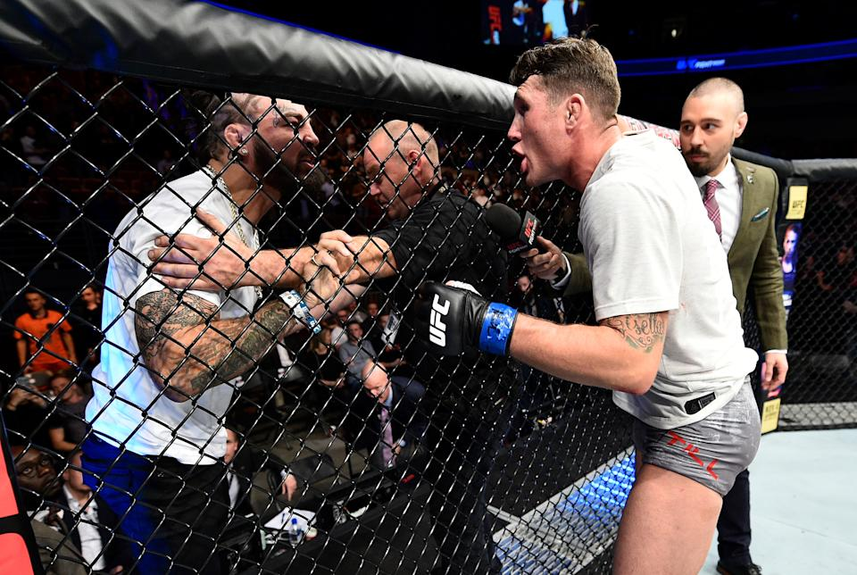 GDANSK, POLAND - OCTOBER 21:  (R-L) Darren Till of England has words with Mike Perry after his victory over Donald Cerrone during the UFC Fight Night event inside Ergo Arena on October 21, 2017 in Gdansk, Poland. (Photo by Jeff Bottari/Zuffa LLC/Zuffa LLC via Getty Images)