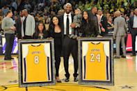 Kobe Bryant posed with his wife, Vanessa, and daughters, Gianna, Natalia and Bianka, at the ceremony for retiring his Lakers jersey Nos. 8 and 24 at the Staples Center in December 2017. (Allen Berezovsky/Getty Images)