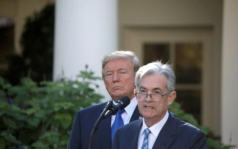 Trump Powell - Credit: Carlos Barria/REUTERS