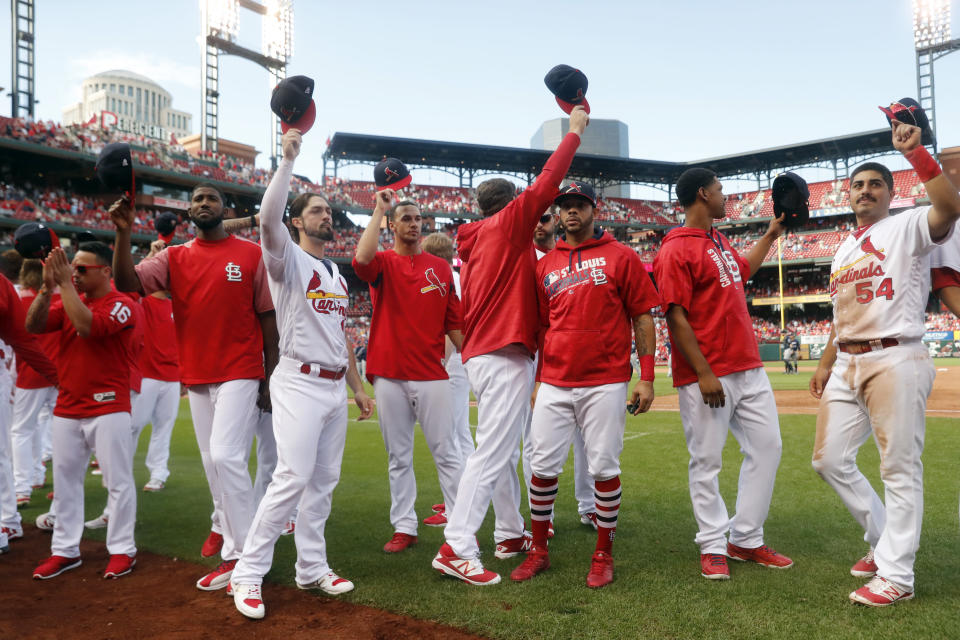 Cardinals players waving goodbye to their fans after the final game of the season, because they would not be going to the playoffs. (AP)