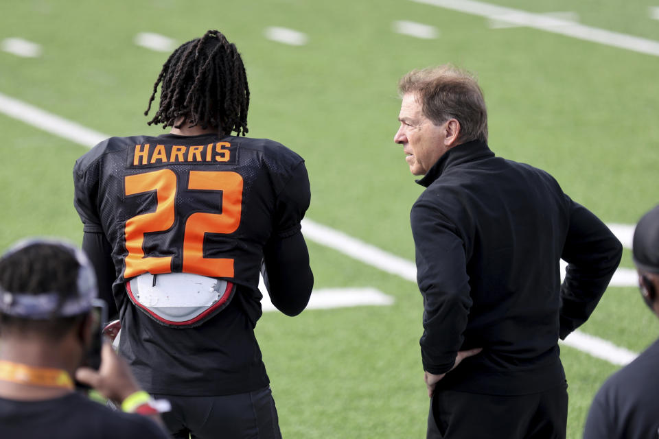 Najee Harris and Alabama head coach Nick Saban chat at the 2021 Senior Bowl. (AP Photo/Rusty Costanza)