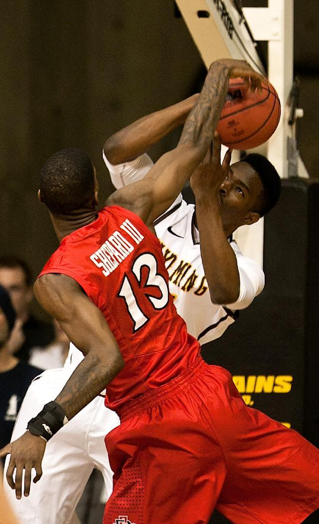San Diego State forward Winston Shepard (13) blocks a shot by University of Wyoming Cowboys forward Dereck Cooke Jr. (11) in a NCAA college basketball game Tuesday, Feb. 11, 2014 at the Arena-Auditorium in Laramie, Wyo. (AP Photo/Jeremy Martin)