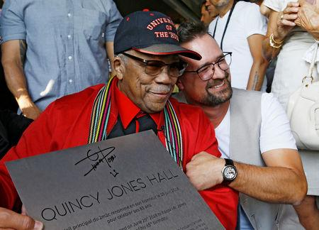 FILE PHOTO: Legendary American producer Jones and Montreux Jazz Festival Director Jaton pose during a ceremony to rename a concert hall to his name during the opening night of the 52nd Montreux Jazz Festival in Montreux