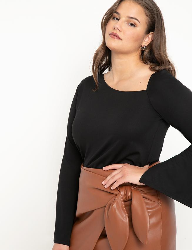 Asymmetric Neckline Top with Sleeve Slits. Image via Eloquii.