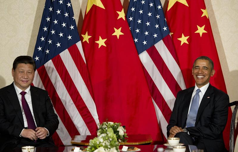 US President Barack Obama and Chinese President Xi Jinping (L) meet at the US ambassador's residence in The Hague on March 24, 2014 ahead of the Nuclear Security Summit (AFP Photo/Saul Loeb)