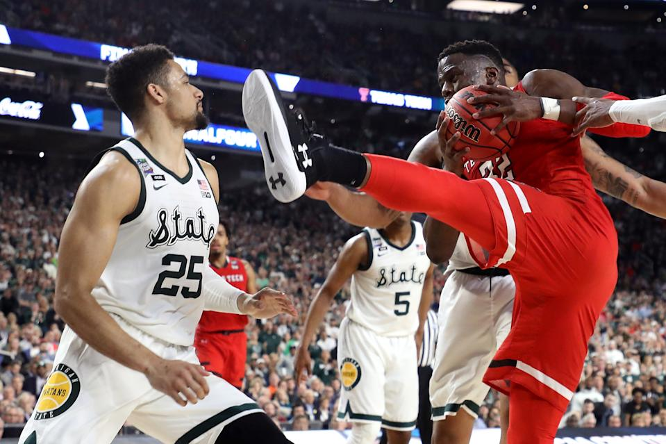 Norense Odiase #32 of the Texas Tech Red Raiders battles for the ball as Kenny Goins #25 of the Michigan State Spartans looks on in the second half during the 2019 NCAA Final Four semifinal at U.S. Bank Stadium on April 6, 2019 in Minneapolis, Minnesota. (Photo by Streeter Lecka/Getty Images)