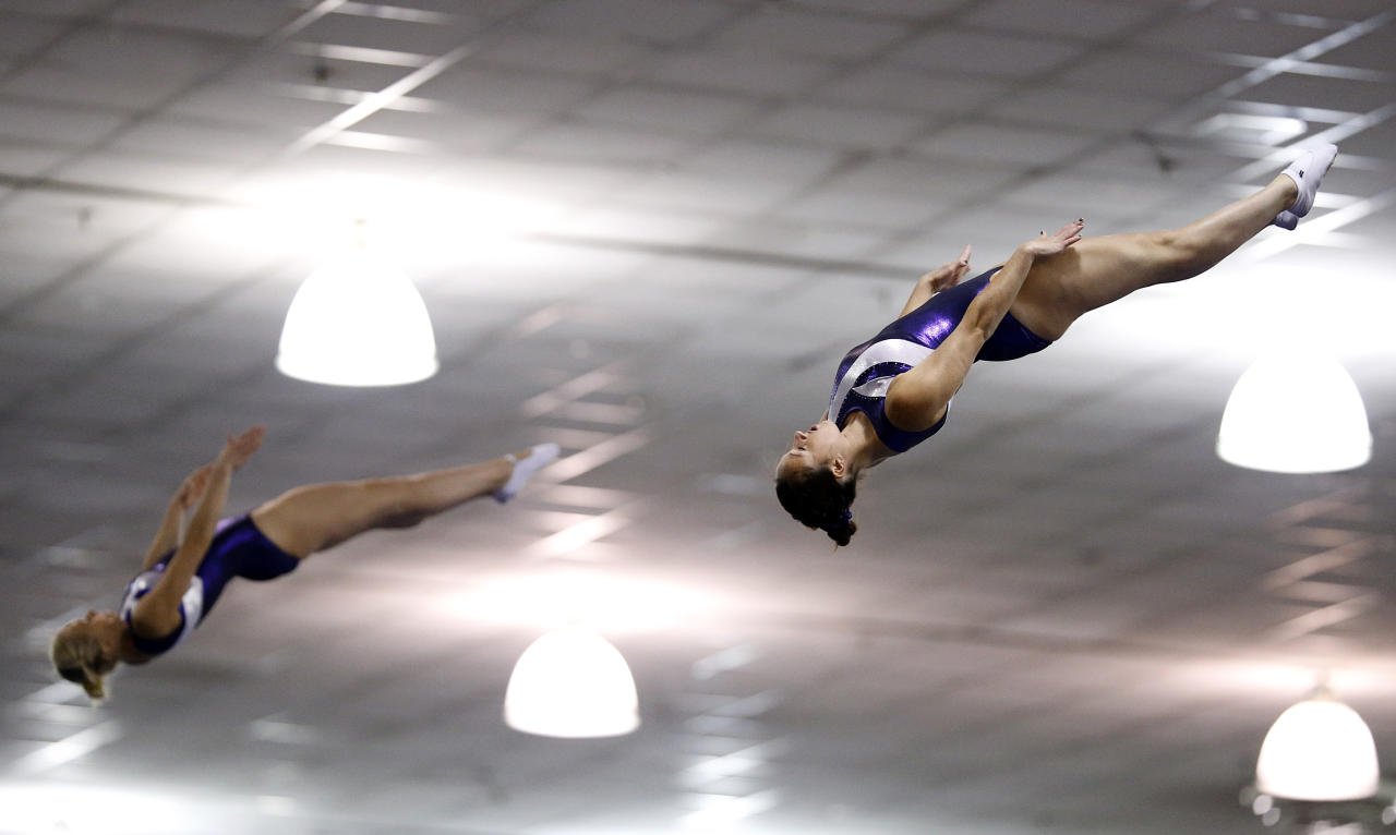 Alicia Powder, right, and Shanelle Landry compete in the synchro trampoline event at the USA Gymnastics Championships in San Jose, Calif., Wednesday, June 27, 2012. The pair placed first. (AP Photo/Jae C. Hong)