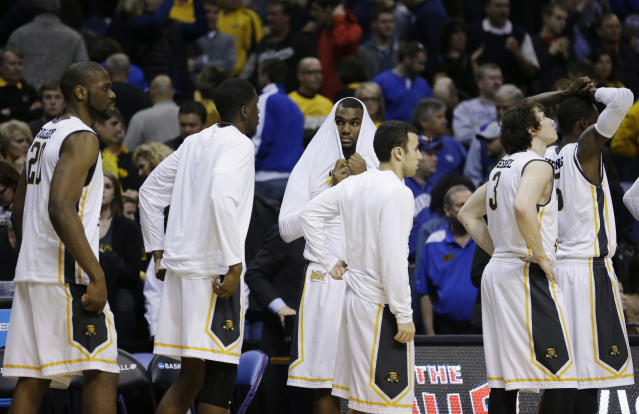 Wichita State lines up after a third-round game against Kentucky at the NCAA college basketball tournament Sunday, March 23, 2014, in St. Louis. Kentucky won 78-76. (AP Photo/Jeff Roberson)