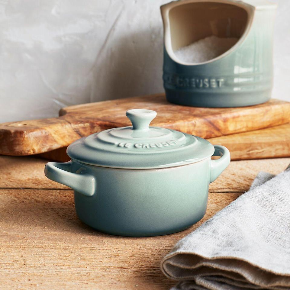 """<p><strong>Le Creuset </strong></p><p>surlatable.com</p><p><a href=""""https://go.redirectingat.com?id=74968X1596630&url=https%3A%2F%2Fwww.surlatable.com%2Fle-creuset-stoneware-petite-casserole-indigo%2FPRO-198613.html&sref=https%3A%2F%2Fwww.cosmopolitan.com%2Flifestyle%2Fg35165150%2Fsur-la-table-sale%2F"""" rel=""""nofollow noopener"""" target=""""_blank"""" data-ylk=""""slk:Shop Now"""" class=""""link rapid-noclick-resp"""">Shop Now</a></p><p><strong><del>$35</del> $19.96 (43% off)</strong></p><p>Pro tip: Pick up a bunch of tiny cocottes and break them out during your next big dinner party. (You know, when you can have dinner parties again.) They're perfect for small sides or a dreamy crème brûlée.</p>"""