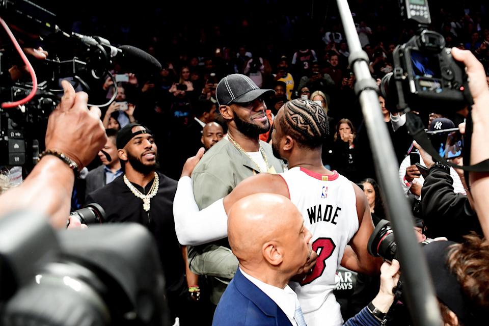NEW YORK, NEW YORK - APRIL 10: Lebron James of the Los Angeles Lakers greets Dwyane Wade #3 of the Miami Heat prior to the game against the Brooklyn Nets at Barclays Center on April 10, 2019 in the Brooklyn borough of New York City. This is Wade's last NBA game before retirement. NOTE TO USER: User expressly acknowledges and agrees that, by downloading and or using this photograph, User is consenting to the terms and conditions of the Getty Images License Agreement.(Photo by Sarah Stier/Getty Images)