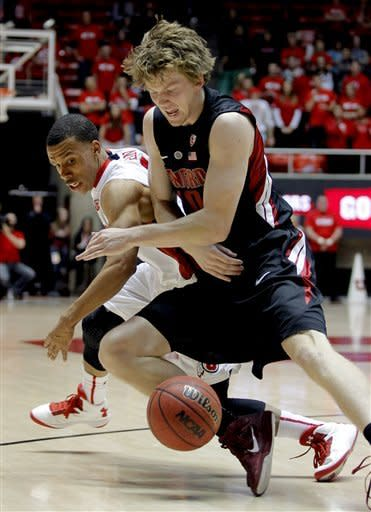 Utah guard Glen Dean, left, and Stanford forward John Gage, right, struggle to get control of a loose ball during the first half of an NCAA college basketball game, Sunday, Jan. 27, 2013, in Salt Lake City. (AP Photo/Steve C. Wilson)