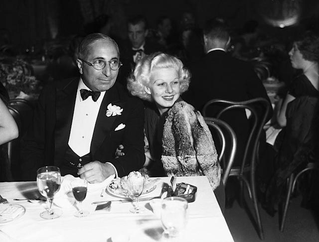 MGM chief Louis B. Mayer dines with one of his stars, Jean Harlow, in 1933. (Photo: Bettmann/Getty Images)