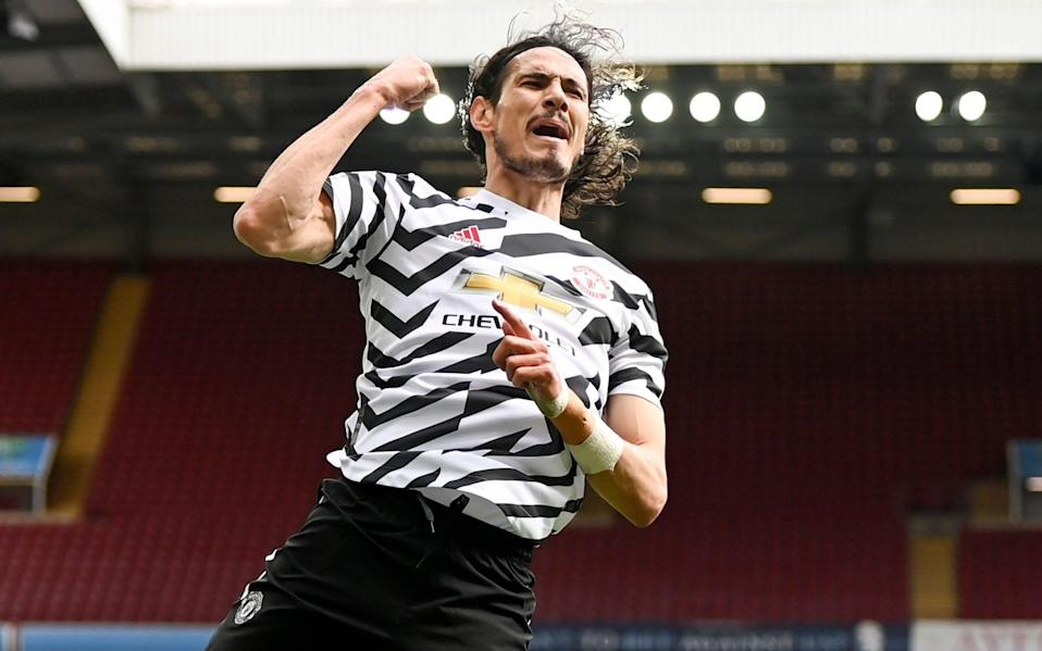 Edinson Cavani of Manchester United celebrates after scoring the 3-1 lead during the English Premier League soccer match between Aston Villa and Manchester United - Shutterstock