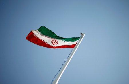 FILE PHOTO: FILE PHOTO: An Iranian national flag flutters during the opening ceremony of the 16th International Oil, Gas & Petrochemical Exhibition (IOGPE) in Tehran April 15, 2011. REUTERS/STR/File Photo