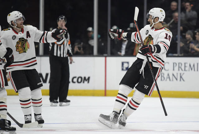 Chicago Blackhawks center Artem Anisimov, right, celebrates his goal with defenseman Duncan Keith during the second period of an NHL hockey game against the Anaheim Ducks on Wednesday, Feb. 27, 2019, in Anaheim, Calif. (AP Photo/Mark J. Terrill)