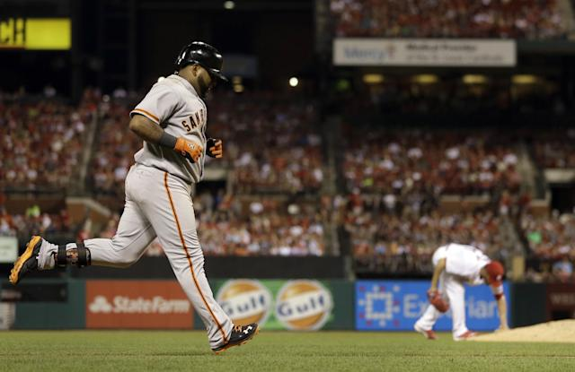 San Francisco Giants' Pablo Sandoval, left, rounds the bases after hitting a solo home run off St. Louis Cardinals starting pitcher Jaime Garcia during the sixth inning of a baseball game, Thursday, May 29, 2014, in St. Louis. (AP Photo/Jeff Roberson)