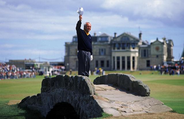 <p>Arnold Palmer of the USA waves to the crowd from the Swilken Bridge on the 18th hole during the second round of the British Open at St Andrews in Scotland. This proved to be a farewell from Palmer as shortly after the round he announced this would be his last British Open appearance. </p>