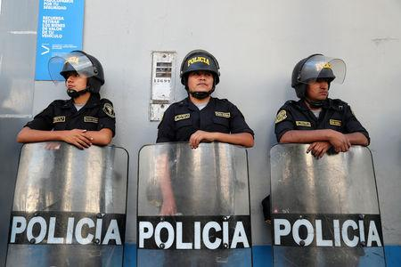 FILE PHOTO: Police officers stand outside the hospital where Peru's former President Kuczynski is hospitalized in Lima
