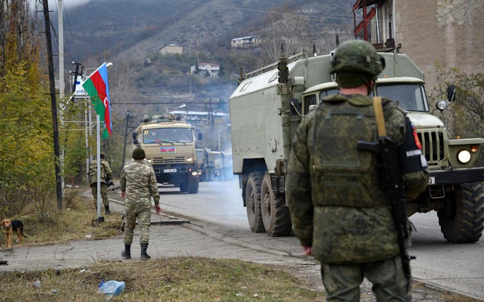 Azerbaijani soldiers and military trucks on December 1 rolled into the final district given up by Armenia - KAREN MINASYAN/AFP via Getty Images