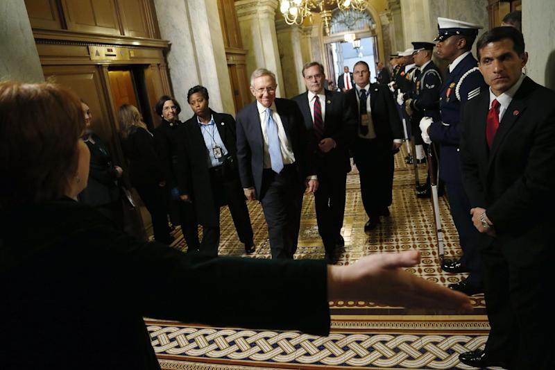 Senate Majority Leader Harry Reid of Nev. arrives on Capitol Hill in Washington, Monday, Jan. 21, 2013, for President Barack Obama's ceremonial swearing-in ceremony during the 57th Presidential Inauguration.  (AP Photo/Jonathan Ernst, Pool)