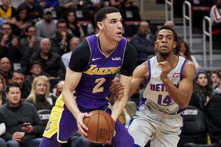 FILE PHOTO: Mar 26, 2018; Detroit, MI, USA; Los Angeles Lakers guard Lonzo Ball (2) dribbles past Detroit Pistons guard Ish Smith (14) in the first half at Little Caesars Arena. Mandatory Credit: Rick Osentoski-USA TODAY Sports/File Photo