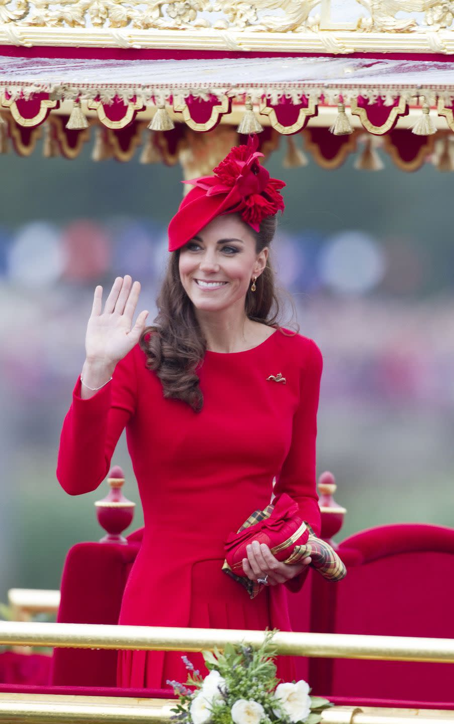 """<p>Kate's wardrobe has always been a subject of controversy. Her conservatively fashionable outfit choices are often called out for one thing or another. So it was unsurprising that she received <a href=""""http://www.dailymail.co.uk/femail/article-2154264/Kate-Middleton-Duchess-Cambridges-scarlet-Diamond-Jubilee-dress-stole-show.html"""" rel=""""nofollow noopener"""" target=""""_blank"""" data-ylk=""""slk:backlash for wearing a bright red dress"""" class=""""link rapid-noclick-resp"""">backlash for wearing a bright red dress</a> to board the royal barge """"Spirit of Chartwell"""" for the Thames Diamond Jubilee Pageant. The rest of the royal family members wore muted colors. </p>"""