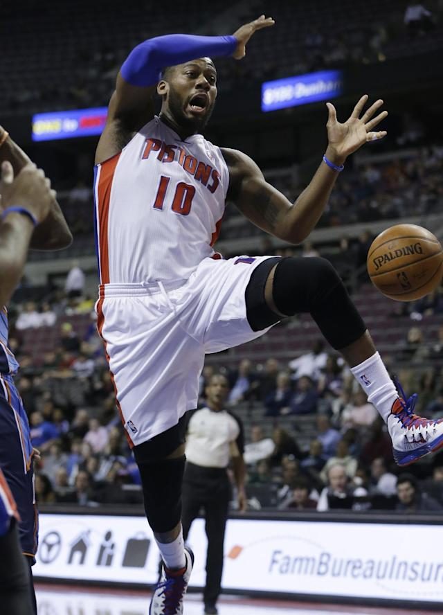 Detroit Pistons forward Greg Monroe (10) loses control of the ball during the first quarter of an NBA basketball game against the Charlotte Bobcats in Auburn Hills, Mich., Tuesday, Feb. 18, 2014. (AP Photo/Carlos Osorio)
