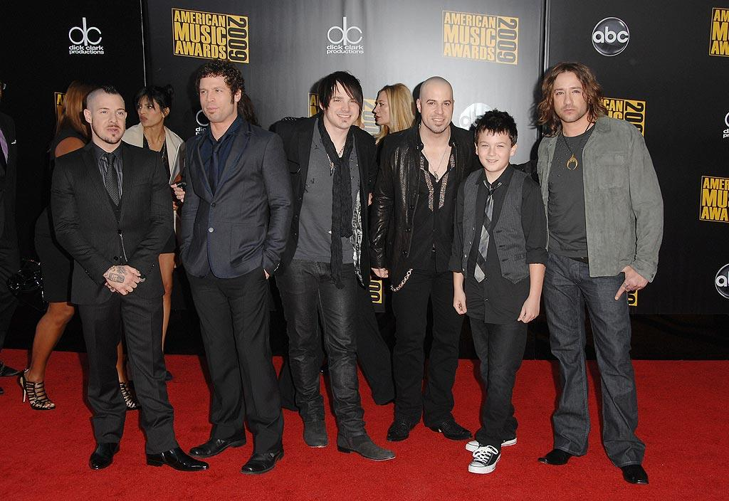 "Daughtry  Grade: B  Chris Daughtry and his bandmates kept things simple and stylish in a multitude of shirts, suits, and boots. Steve Granitz/<a href=""http://www.wireimage.com"" target=""new"">WireImage.com</a> - November 22, 2009"