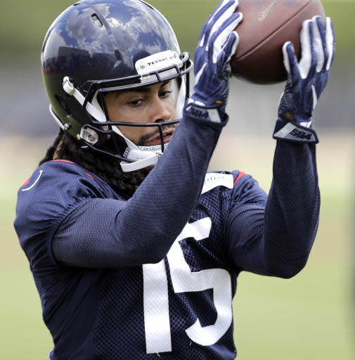 Houston Texans wide receiver Will Fuller catches a pass during an NFL football minicamp Wednesday, June 13, 2018, in Houston. (AP Photo/David J. Phillip)