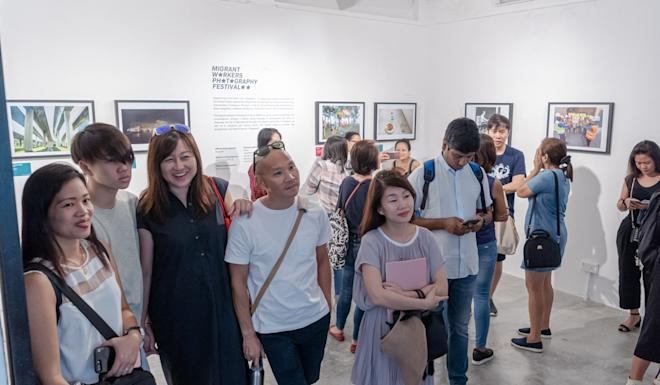 People attend the photo exhibition. Photo: Handout