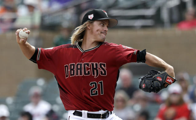 FILE - In this Thursday, March 7, 2019, file photo, Arizona Diamondbacks starting pitcher Zack Greinke throws against the Cleveland Indians in the first inning of a spring training baseball game in Scottsdale, Ariz. With key players still on the roster and new players who should fill at least some of the void, the Diamondbacks are hoping to compete for a playoff spot even with one of baseball's best players on a new team. (AP Photo/Elaine Thompson, File)