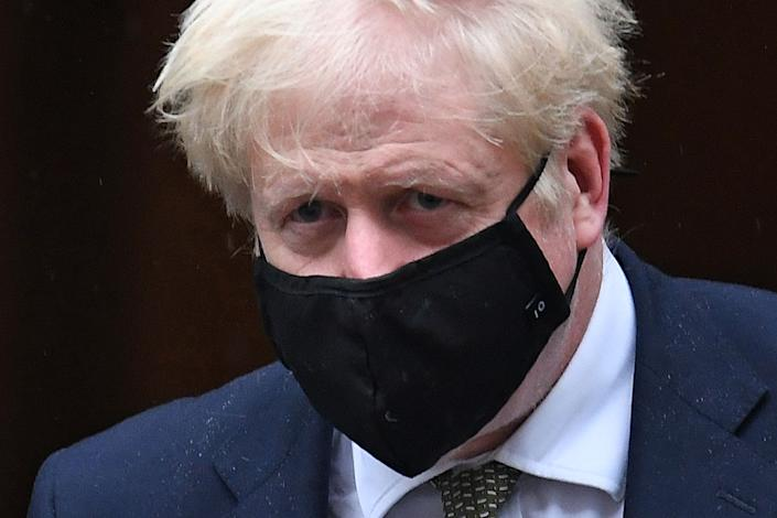 Britain's Prime Minister Boris Johnson wearing a face mask as a precaution against the transmission of the novel coronavirus leaves 10 Downing Street in central London on October 12, 2020 headed for the House of Commons, where he is set to announce a new COVID-19 alert system. - British Prime Minister Boris Johnson was set to present a new three-tiered alert system for coronavirus cases in England on Monday, with Liverpool in the northwest expected to be the only city placed in the top category. (Photo by Daniel LEAL-OLIVAS / AFP) (Photo by DANIEL LEAL-OLIVAS/AFP via Getty Images)