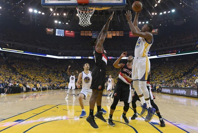 Kevin Durant of the Golden State Warriors goes up for a layup over Noah Vonleh of the Portland Trail Blazers in the first quarter during Game One of the 2017 NBA playoffs quarter-finals, in Oakland, on April 16