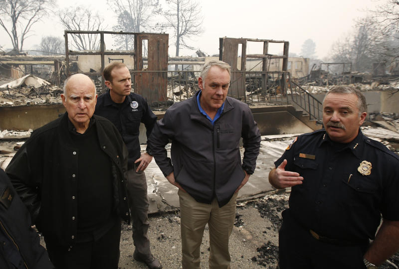 (From left) California Gov. Jerry Brown, Federal Emergency Management Agency Director Brock Long, Interior Secretary Ryan Zinke and Cal Fire's Scott Upton at the fire-ravaged Paradise Elementary School, Nov. 14, in Paradise, California. (ASSOCIATED PRESS)