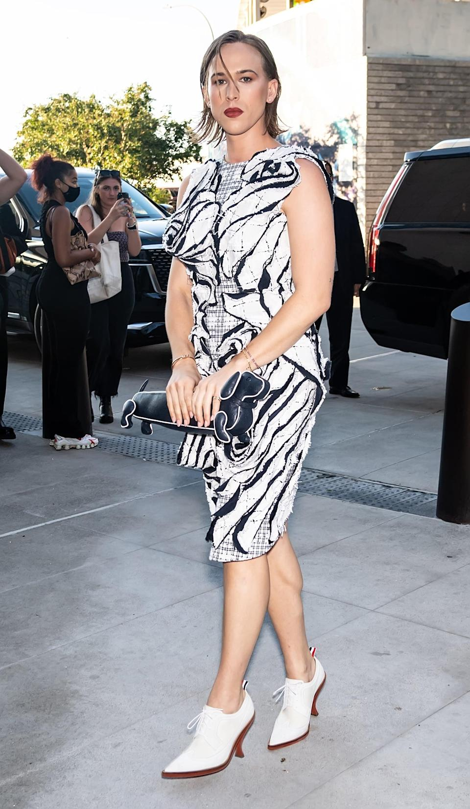<p>She chose a black-and-white printed dress and lace-up booties for the occasion.</p>