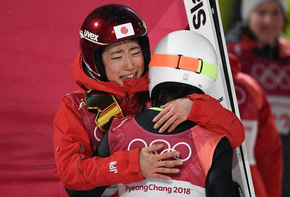 <p>Japan's Kaori Iwabuchi (L) hugs her compatriot Sara Takanashi after winning the bronze medal in the women's normal hill individual ski jumping event during the Pyeongchang 2018 Winter Olympic Games on February 12, 2018, in Pyeongchang. </p>